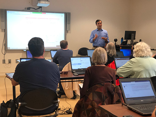 Jon Ernstberger describes online learning techniques to a group of faculty.